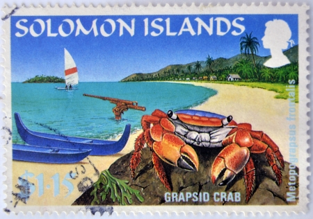 SOLOMON ISLANDS - CIRCA 2000: A stamp printed in Solomon islands shows a grapsid crab on a beach paradise, circa 2000 photo