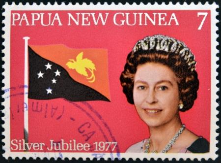 PAPUA NEW GUINEA - CIRCA 1977  stamp printed in Papua New Guinea shows aportrait elizabeth II, silver jubilee in commemoration, circa 1977  Editorial