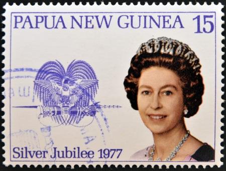 PAPUA NEW GUINEA - CIRCA 1977  stamp printed in Papua New Guinea shows aportrait elizabeth II, silver jubilee in commemoration, circa 1977
