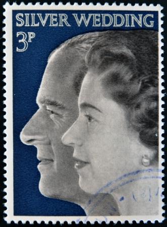 silver wedding anniversary: UNITED KINGDOM- CIRCA 1972  A stamp printed in Great Britian shows Queen Elizabeth II and Duke of Edinburgh, commemoration their silver wedding anniversary, circa 1972