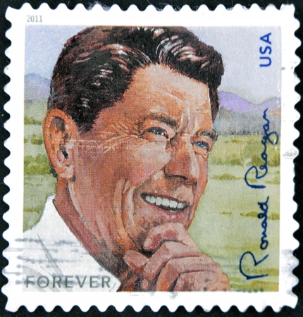 ronald reagan: UNITED STATES OF AMERICA - CIRCA 2011  A stamp printed in USA shows image of President Ronald Reagan,  circa 2011