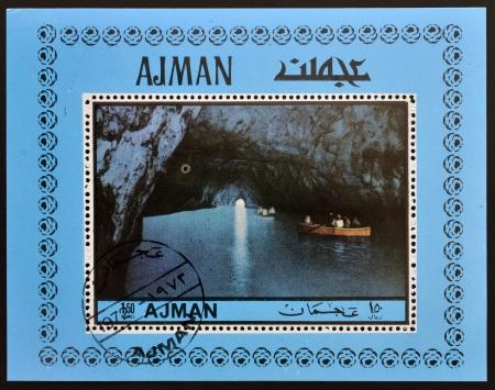 AJMAN - CIRCA 1972 : stamp printed in Ajman shows the Blue Grotto in Capri, Italy, circa 1972 photo