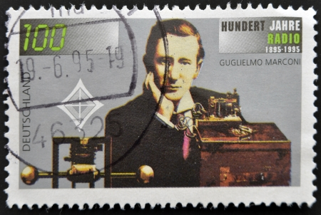 transmitting: GERMANY - CIRCA 1995: a stamp printed in Germany shows Guglielmo Marconi and Transmitting Equipment, Centenary of Radio, circa 1995  Editorial