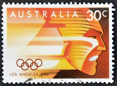 summer olympics: AUSTRALIA - CIRCA 1984: A stamp printed in Australia shows image of celebrating the 1984 Summer Olympics in Los Angeles, circa 1984