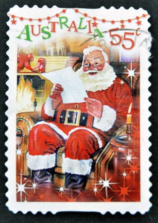 AUSTRALIA - CIRCA 2010: A stamp printed in Australia shows Santa Claus reading the letter, circa 2010 photo