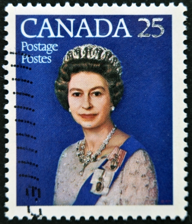 canada stamp: CANADA - CIRCA 1977: A stamp printed in Canada shows queen Elizabeth II, Silver Jubilee, circa 1977 Editorial