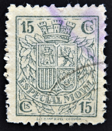 SPAIN - CIRCA 1923: A stamp printed in Spain shows a shield of Spain before the Habsburgs with leaves of laurel and oak, Dictatorship of Primo de Rivera, circa 1923 photo
