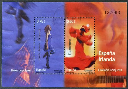 SPAIN - CIRCA 2008: Stamps printed in Spain dedicated to popular dances shows woman dancing flamenco and dance irish, circa 2008