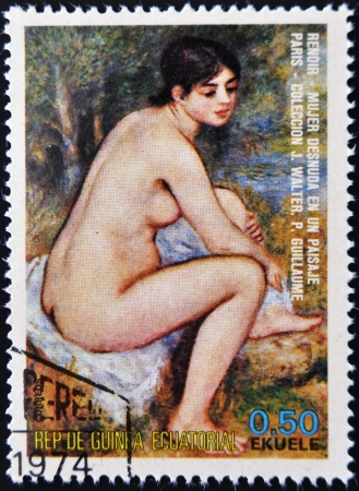 EQUATORIAL GUINEA - CIRCA 1974: A stamp printed in Equatorial Guinea dedicated to the female nude in art history shows naked woman in a landscape by Renoir, circa 1974  Stock Photo - 14521156