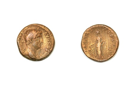 hadrian: Ancient Roman coin on a white background. Emperor Hadrian and allegory of the civic pax  Stock Photo