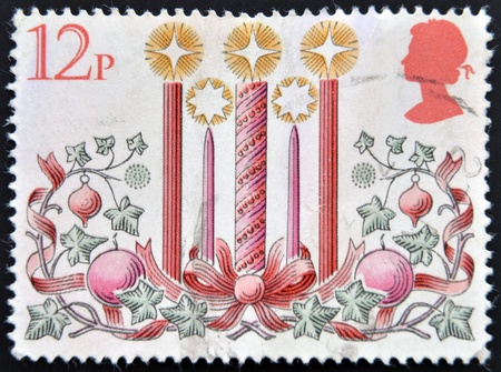 UNITED KINGDOM - CIRCA 1980 : A stamp printed in Great Britain showing Christmas Candle Decorations, circa 1980  Stock Photo - 14531892