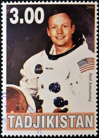 TAJIKISTAN - CIRCA 2000: A stamp printed in Tajikistan shows Neil Armstrong, circa 2000