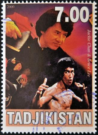 postmarked: TAJIKISTAN - CIRCA 2000: A stamp printed in Tajikistan shows Bruce Lee and Jackie Chan, circa 2000