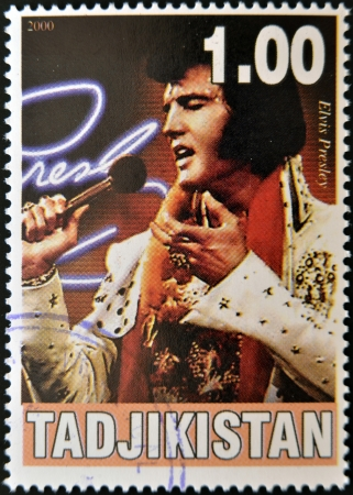 TAJIKISTAN - CIRCA 2000: A stamp printed in Tajikistan shows Elvis Presley, circa 2000