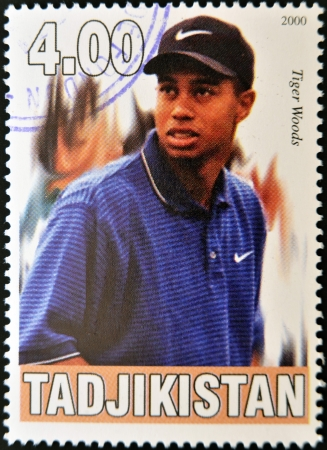 TAJIKISTAN - CIRCA 2000: A stamp printed in Tajikistan shows Tiger Woods, circa 2000