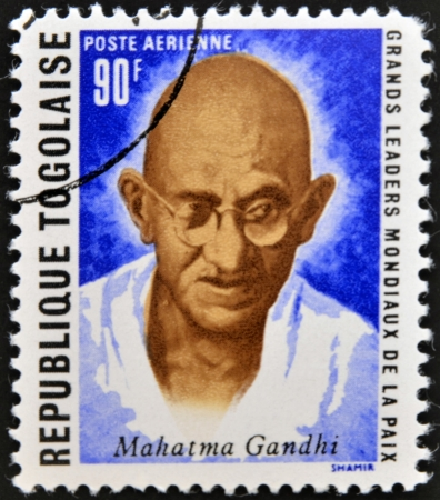 nonviolent: REPUBLIC OF TOGO - CIRCA 1969: A stamp printed in Togo dedicated to great world leaders of peace, shows Mahatma Gandhi, circa 1969