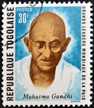 mahatma: REPUBLIC OF TOGO - CIRCA 1969: A stamp printed in Togo dedicated to great world leaders of peace, shows Mahatma Gandhi, circa 1969