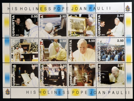 UDMURTIA - CIRCA 2003: Collection stamps printed in Udmurtia shows Pope John Paul II, circa 2003 Stock Photo - 14521098