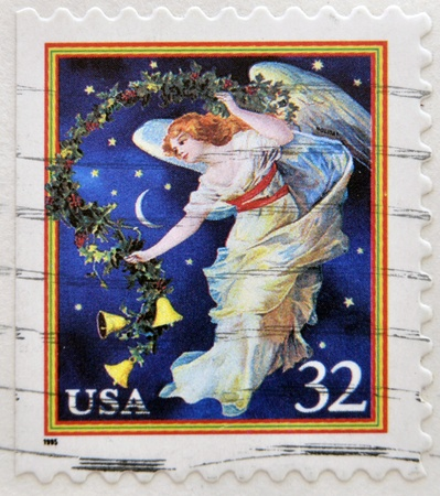 UNITED STATES OF AMERICA - CIRCA 1995: A stamp printed in USA shows midnight angel, holiday, circa 1995  photo