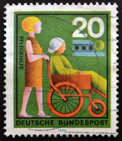 GERMANY - CIRCA 1970: a stamp printed in  Germany shows woman Assisting Elderly Woman, circa 1970