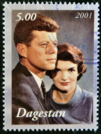 kennedy: DAGESTAN - CIRCA 2001: A stamp printed in Republic of Dagestan shows John F Kennedy with wife Jacqueline, circa 2001