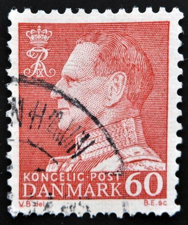 ix portrait: DENMARK - CIRCA 1969: A stamp printed in Denmark shows image of King Frederick IX, circa 1969  Editorial