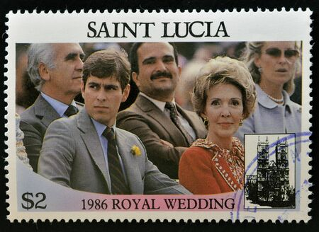 queen elizabeth ii: SAINT LUCIA - CIRCA 1986: A stamp printed in Saint Lucia shows a portrait of Prince Andrew of England and Nancy Reagan watching a parade, the royal wedding commemorative, circa 1986