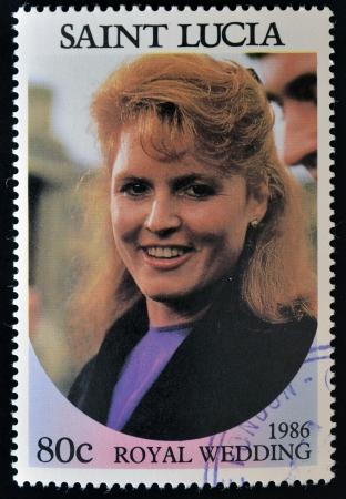 queen elizabeth ii: SAINT LUCIA - CIRCA 1986: A stamp printed in Saint Lucia shows  a portrait of  Sarah Margaret Ferguson,the royal wedding commemorative, circa 1986 Editorial