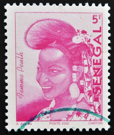 SENEGAL - CIRCA 2002: A stamp printed by Senegal, shows a woman of elegance Senegalese, Fulani women, circa 2002