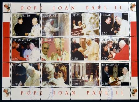 catholism: UDMURTIA - CIRCA 2003: Collection stamps printed in Udmurtia shows Pope John Paul II, circa 2003