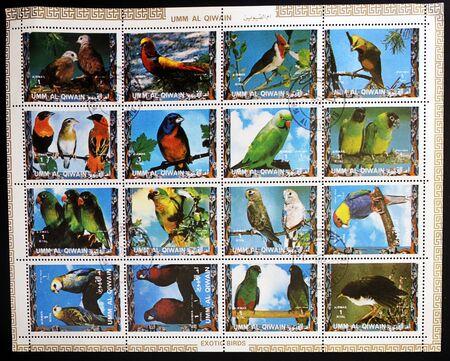 UMM AL QIWAIN - CIRCA 1973: Collection stamps printed in Umm al Qiwain shows Parrots, circa 1973