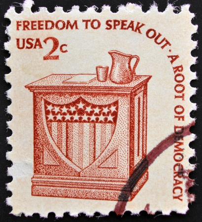UNITED STATES OF AMERICA - CIRCA 1985: A stamp printed in USA shows words freedom to speak - a root of democracy, circa 1985