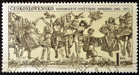 CZECHOSLOVAKIA - CIRCA 1975: A stamp printed in Czechoslovakia shows happy people in remembrance of the liberation, circa 1975 Stock Photo - 14678135