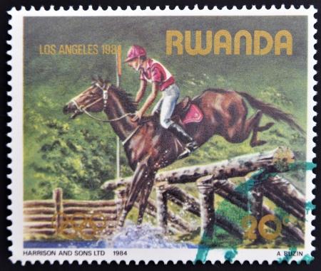 RWANDA - CIRCA 1984: A stamp printed in Rwanda shows Horse Show jumping, circa 1984 Stock Photo - 14677992