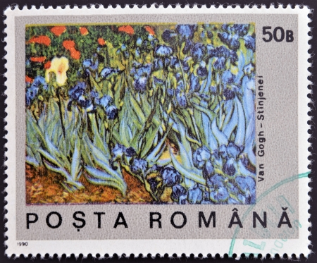 ROMANIA - CIRCA 1990: A stamp printed in Romania shows Field of Irises by Vincent Van Gogh, circa 1990  photo