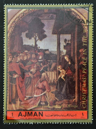 ajman: AJMAN - CIRCA 1972: A stamp printed in Ajman Christmas collection, peace in the world, shows the Adoration of the Magi painted by Perugino , circa 1972
