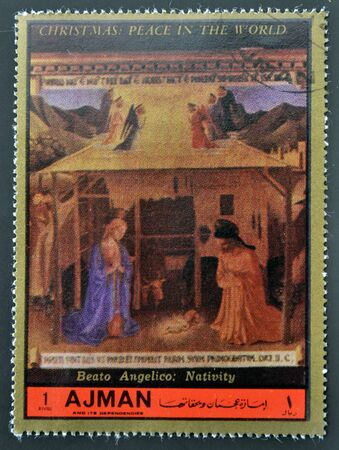 AJMAN - CIRCA 1972: A stamp printed in Ajman  Christmas collection, peace in the world, shows the work of Fra Angelico Nativity , circa 1972