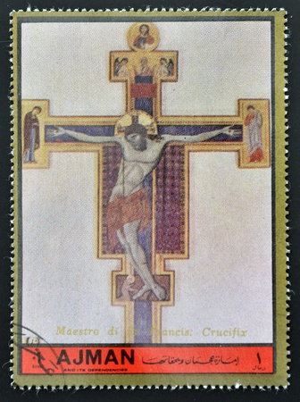 ajman: AJMAN - CIRCA 1972: A stamp printed in Ajman, Christmas collection, peace in the world, shows a painting of the crucifixion of Christ by the Master gave St. Francis , circa 1972