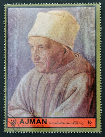 ajman: AJMAN - CIRCA 1972: A stamp printed in Ajman Christmas collection, peace in the world, shows portrait of an old man painted by Lippi, circa 1972  Editorial