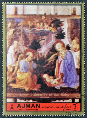 ajman: AJMAN - CIRCA 1972: A stamp printed in Ajman Christmas collection, peace in the world, shows the Adoration of the Baby painted by Lippi , circa 1972