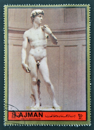 ajman: AJMAN - CIRCA 1972: A stamp printed in Ajman  Christmas collection, peace in the world, shows the sculpture of David made by Michelangelo , circa 1972