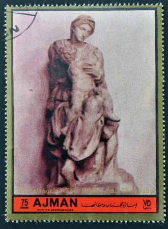 AJMAN - CIRCA 1972: A stamp printed in Ajman  Christmas collection, peace in the world, shows the sculpture of The Virgin and The Baby, made by Michelangelo , circa 1972