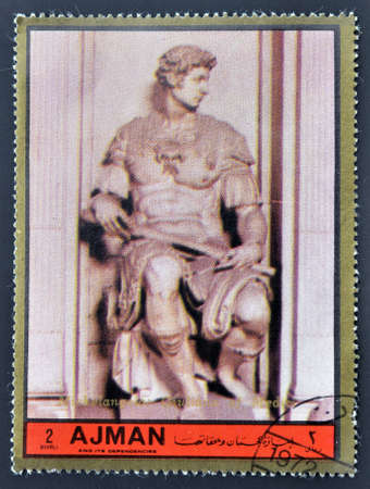 ajman: AJMAN - CIRCA 1972: A stamp printed in Ajman  Christmas collection, peace in the world, shows the sculpture of Giuliano de Medicci, made by Michelangelo , circa 1972  Editorial