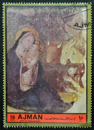 AJMAN - CIRCA 1972: A stamp printed in Ajman  Christmas collection, peace in the world,shows the Nativity of the XIV century painting, circa 1972  photo