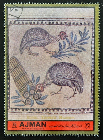 AJMAN - CIRCA 1972: A stamp printed in Ajman  Christmas collection, peace in the world, fresh piece of the terme´s museum in Rome, shows two turkeys and the Tower of Pisa , circa 1972
