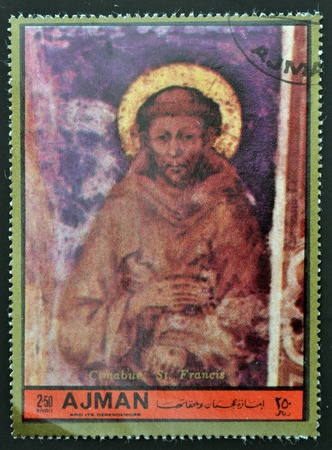 AJMAN - CIRCA 1972: A stamp printed in Ajman  Christmas collection, peace in the world , shows St. Francis painted by Cimabue , circa 1972  photo