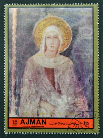 simone: AJMAN - CIRCA 1972: A stamp printed in Ajman  Christmas collection, peace in the world, shows St. Chiara painted by Simone Martini , circa 1972  Editorial