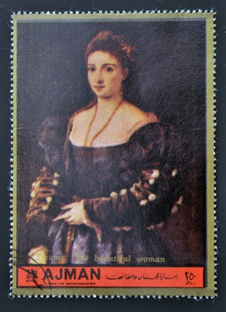 ajman: AJMAN - CIRCA 1972: A stamp printed in Ajman  Christmas collection, peace in the world,shows portrait of the beautiful woman by Titian, circa 1972