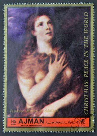 ajman: AJMAN - CIRCA 1972: A stamp printed in Ajman  Christmas collection, peace in the world,shows portrait of Maria Maddalena by Titian, circa 1972