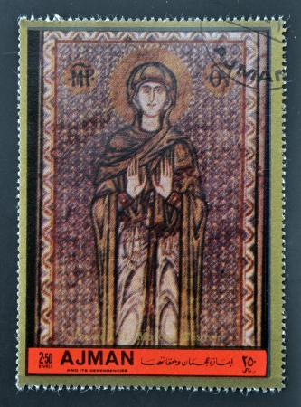 ajman: AJMAN - CIRCA 1972: A stamp printed in Ajman  Christmas collection, peace in the world, shows  The Virgin of the church of St. Marcus in Venice , circa 1972  Stock Photo